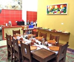 The breakfast table at La Gargola Guesthouse in Old Havana, Cuba