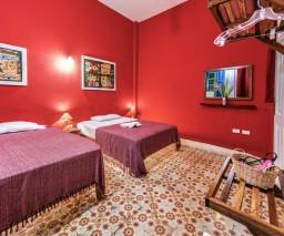 The Red Room in La Gargola Hostal, Havana, Cuba