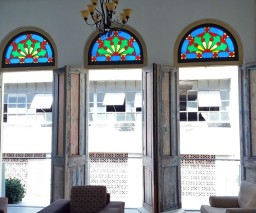 Large doorways with stained glass arches in Old Havana, Cuba