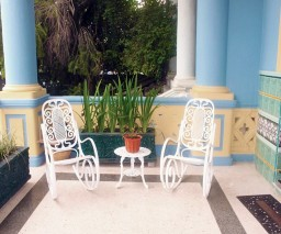 Classic Cuban rocking chairs on a porch in Havana