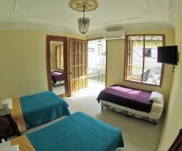 natural light streams into a guest room in Vedado, Havana