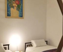 Polygonal bedroom mirror in Havana guesthouse