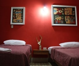 The Red Room of La Gargola guesthouse in Old Havana, Cuba